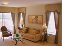 Shaped cornice and drapes for living room windows in NYC