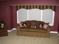Box pleated tapered valance and honeycomb shades for living room windows