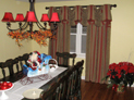 Empire valance on decorative hardware and drapes for dining room window