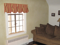Queen Anne valance and wood blinds for living room window in Westchester, New York